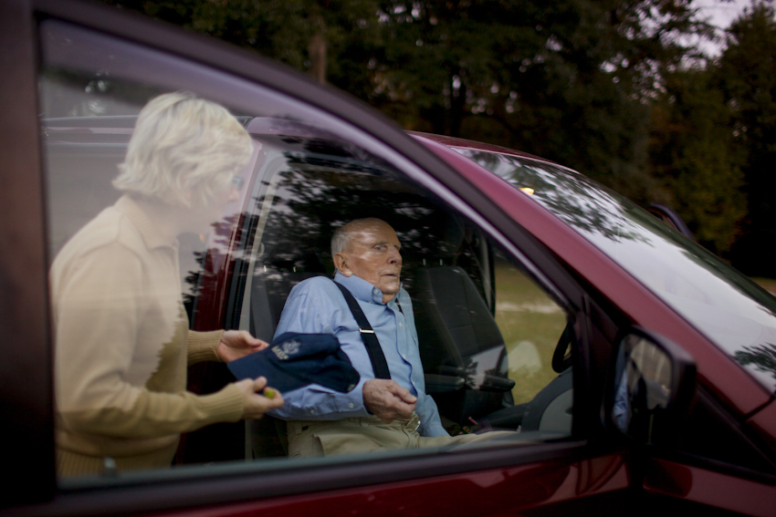 Chris Frampton assits her father into the car after taking a walk in a nearby soy bean field close to the house that Mr. Frampton grew up in. Varnville, SC. Nov. 2014