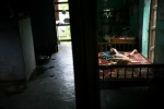Nguyen Quang, 11, on his bed at home in the Kim Dong district of Hai Phong, Vietnam. Village presidents believe most of the children to be third generation Agent Orange victims due to the commonality in mental disorders and physical deformities.