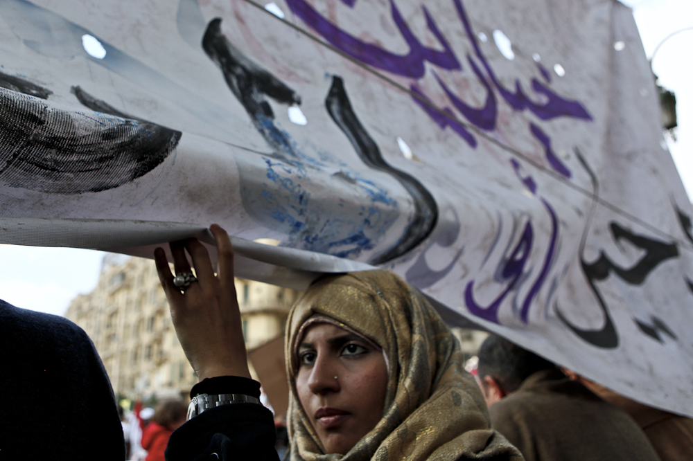 An Egyptian female protester takes part in demonstrations at Tahrir Square in Cairo. Tuesday, February 8, 2011