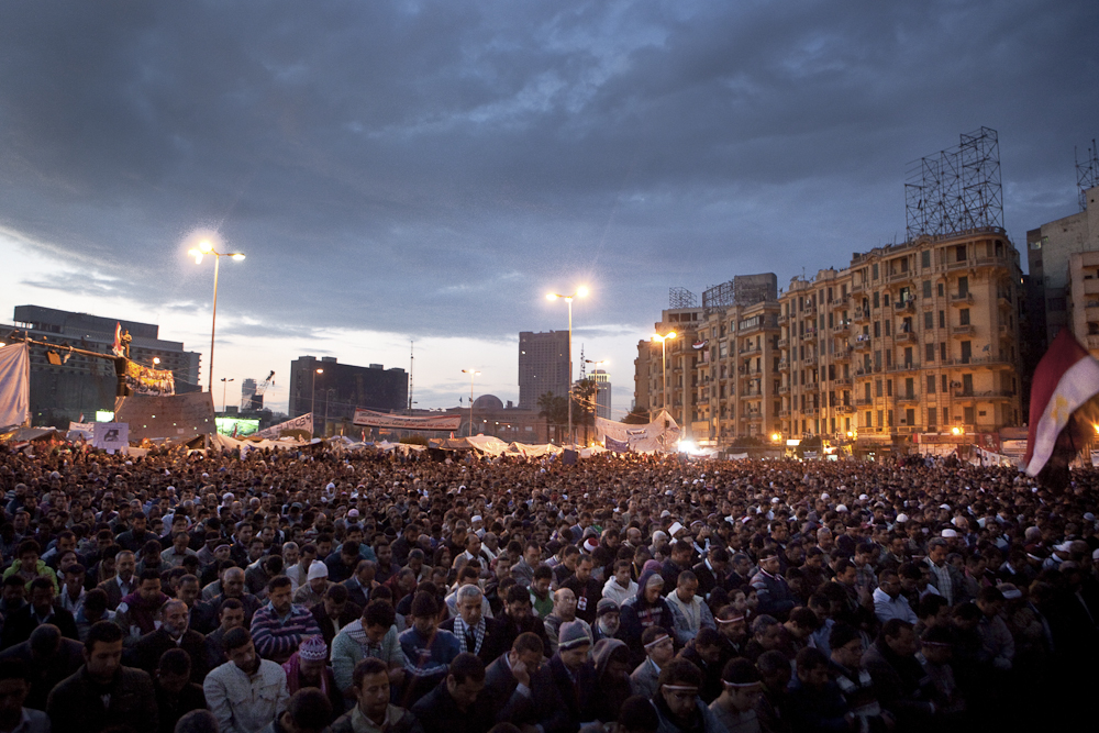 Hundreds of opposition supporters attend Friday prayer at Tahrir Square, before the announcement is made that Hosni Mubarak stepped down. Cairo, Egypt, Friday, February 11, 2011.