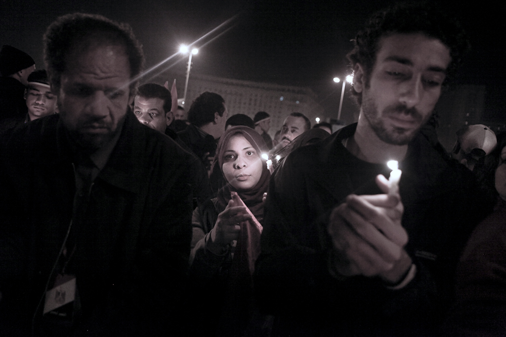 Muslims and Christians alike, join together and take part in a candlelight vigil for the people who were killed during the uprising. Cairo, Wednesday, February 9, 2011