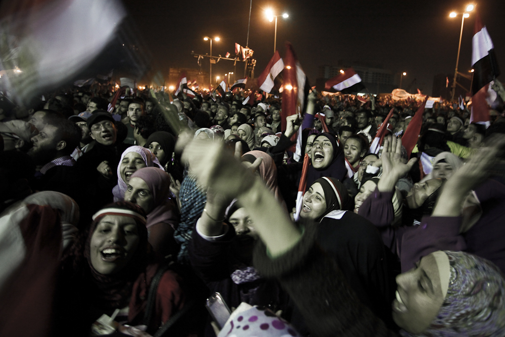Female demonstrators celebrate in Tahrir Square after hearing news that President Hosni Mubarak has resigned. Cairo, Friday, February 11, 2011