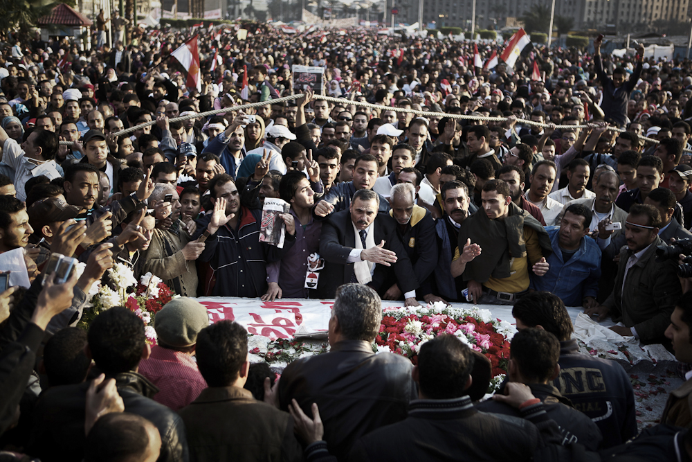 Egyptians join together and take part in a memorial service for the people who were killed during the uprising at Tahrir Square. Cairo, February 12, 2011