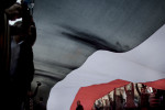 Proud Egyptians carry a giant national flag through Tahrir Square in Cairo.Tuesday, February 8, 2011.