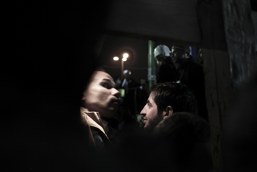 Protesters perform searches on people entering Tahrir Square in downtown Cairo. Thursday, February 10, 2011