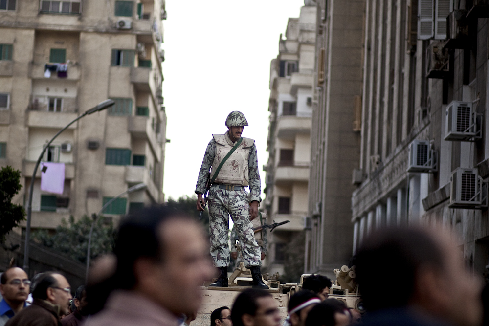 An Egyptian soldier atop an army tank contiues to keep watch of opposition supporters during a rally outside of Tahrir Square. Cairo. February 9, 2011
