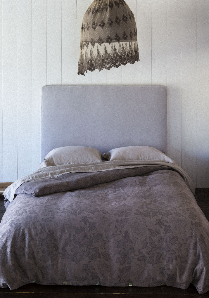 Linen Standard Shams in Flax, Linen Fitted and Flat Sheet in Flax, Vivianne Duvet Cover in Sable, Velvet headboard in Pebble, Hanging lamp: Olivia over Linen Whisper in Sable