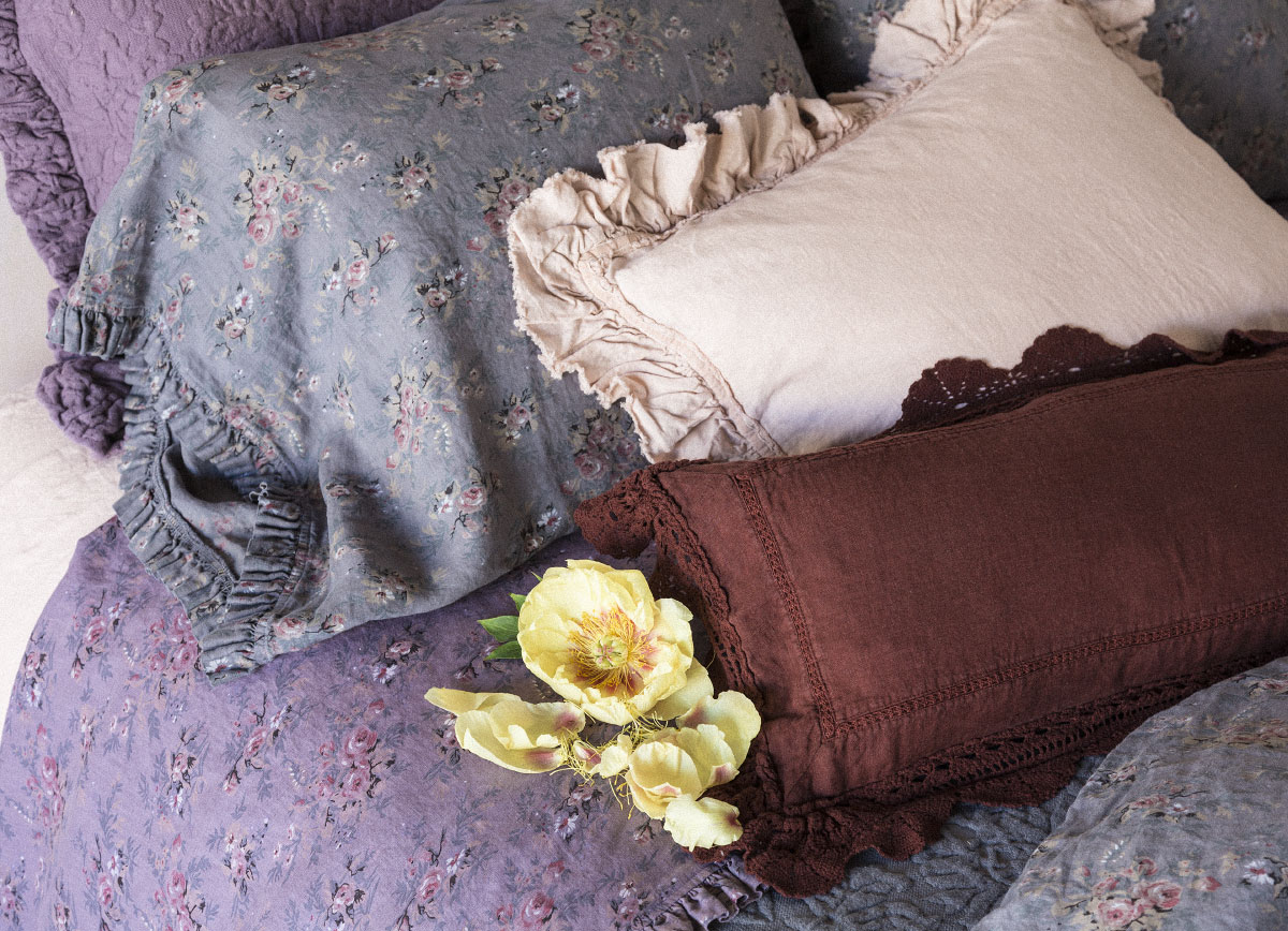 Amalie Euro Sham in Amethyst, Betty Standard Pillowcases in Grahite, Allysa Standard Sham in Perfect Peach, Linen with Crochet Lace Kidney Pillow in Bordeaux, Linen Fitted Sheet in Perfect Peach, Betty Flat Sheet in Amethyst, Amalie Coverlet in Graphite, Betty Duvet Cover in Graphite