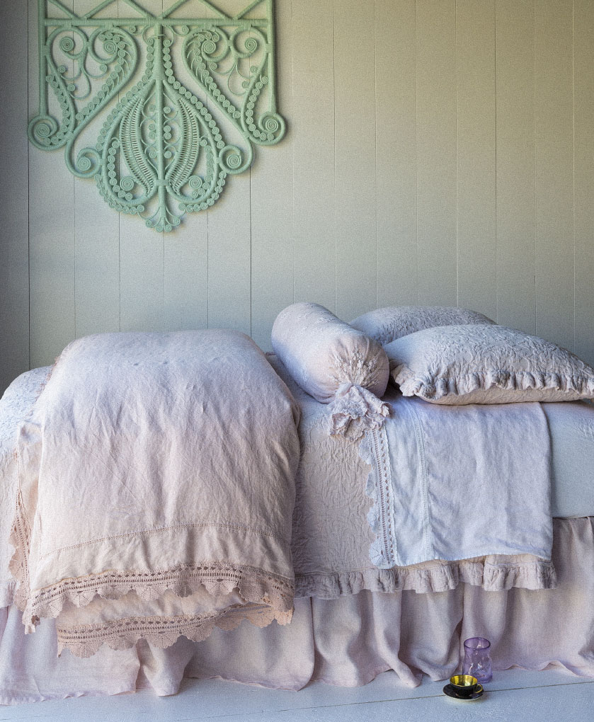 Linen with Crochet Lace Duvet Cover in Perfect Peach, Amalie Coverlet in Petal, Amalie Euro Shams in Petal, Olivia Bolster in Petal over Linen Bolster in Perfect Peach, Linen with Crochet Lace Flat Sheet in White, Linen Fitted Sheet in White, Linen Dust Ruffle in Petal