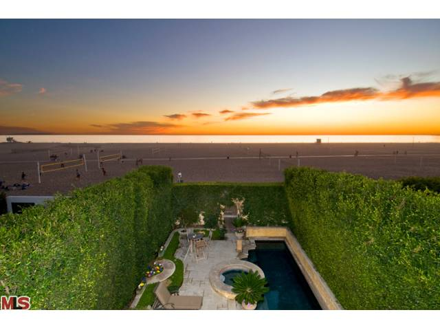 Deep sandy beach on Santa Monica's Gold Coast.  Private, gated ocean front estate