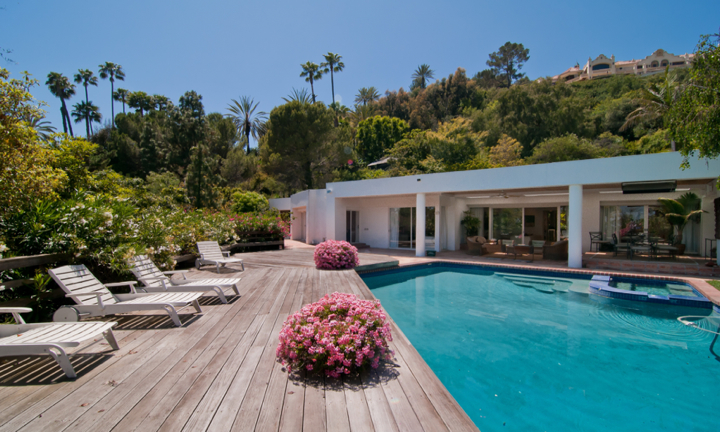 Elegant contemporary home set amidst lush, mature greenery within close proximity to the Beverly Hills Hotel.