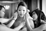 The bride has some last minute touch-up done, with the help of her bridesmaids, at the Washington Athletic Club (WAC) prior to the start of the wedding at the Seattle Aquarium. (Wedding Photography by Scott Eklund/Red Box Pictures)