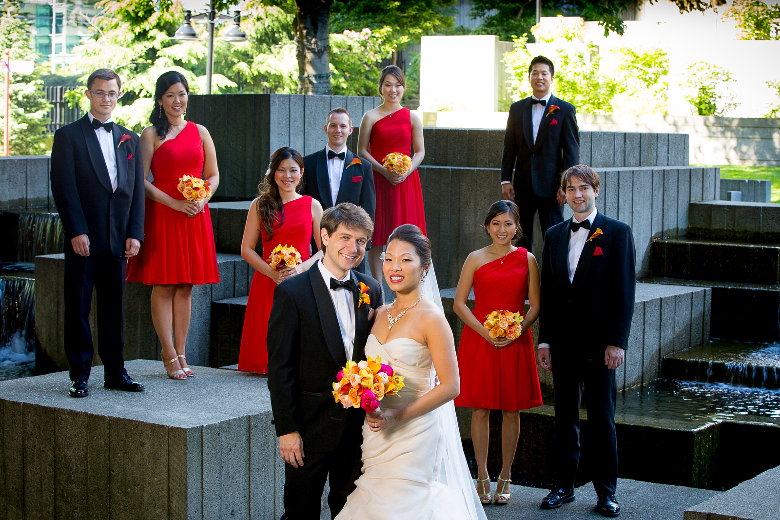 The wedding party poses for a group portrait at Freeway Park in downtown Seattle prior to the wedding at the Seattle Aquarium. (Wedding Photography by Scott Eklund - Red Box Pictures)