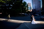 The bride and groom share a kiss in downtown Seattle prior to the start of their wedding at the Seattle Aquarium. (Wedding Photography by Scott Eklund - Red Box Pictures)