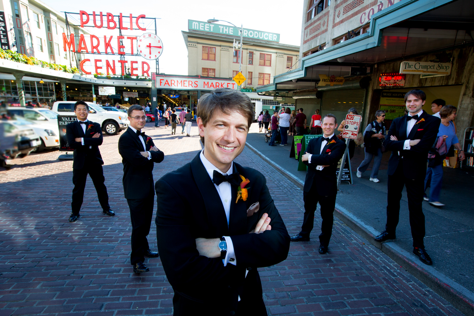 The groom and his groomsmen pose for a portrait at the Pike Place Market prior to the wedding at the Seattle Aquarium. (Wedding Photography by Scott Eklund - Red Box Pictures)