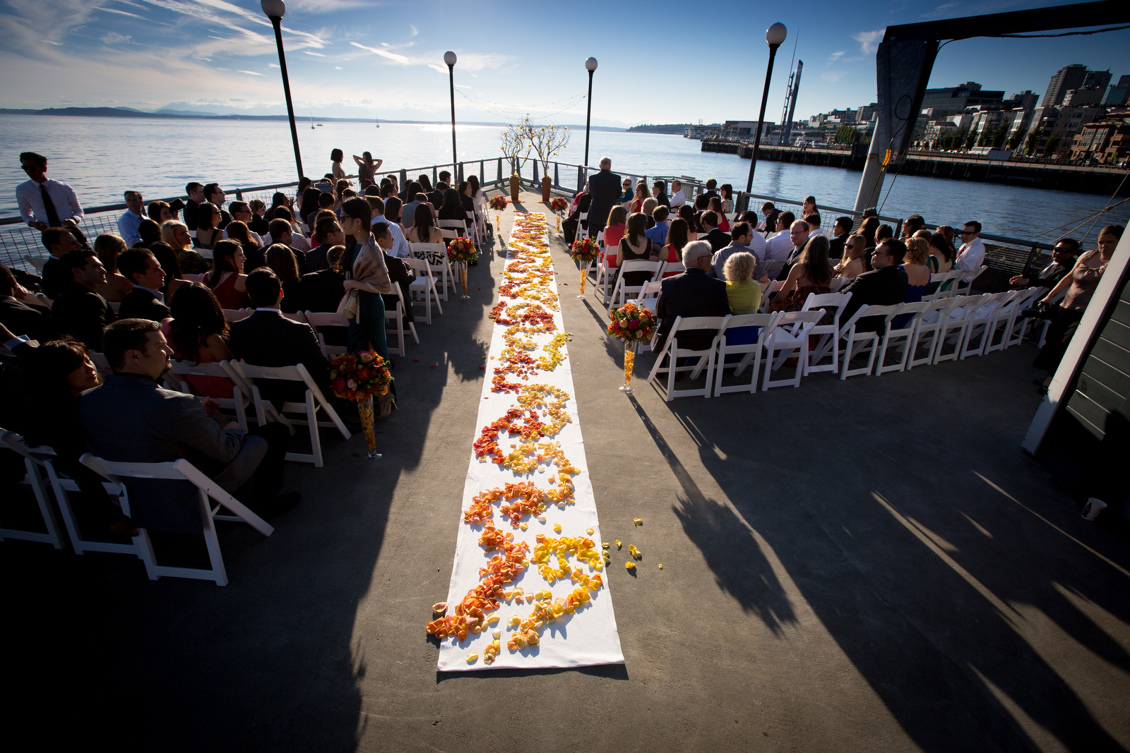 The aisle is decorated with flowers prior to the start of the wedding ceremony of Alina & Patrick at the Seattle Aquarium. (Wedding Photography by Scott Eklund/Red Box Pictures)