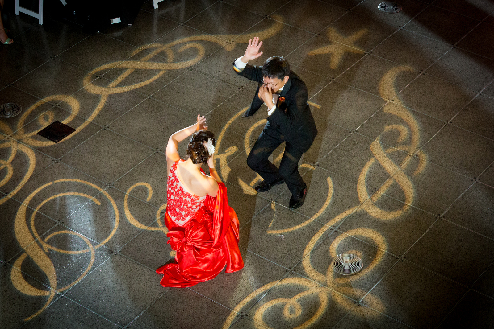 The bride and her father dance during the wedding reception at the Seattle Aquarium. (Wedding Photography by Scott Eklund/Red Box Pictures)