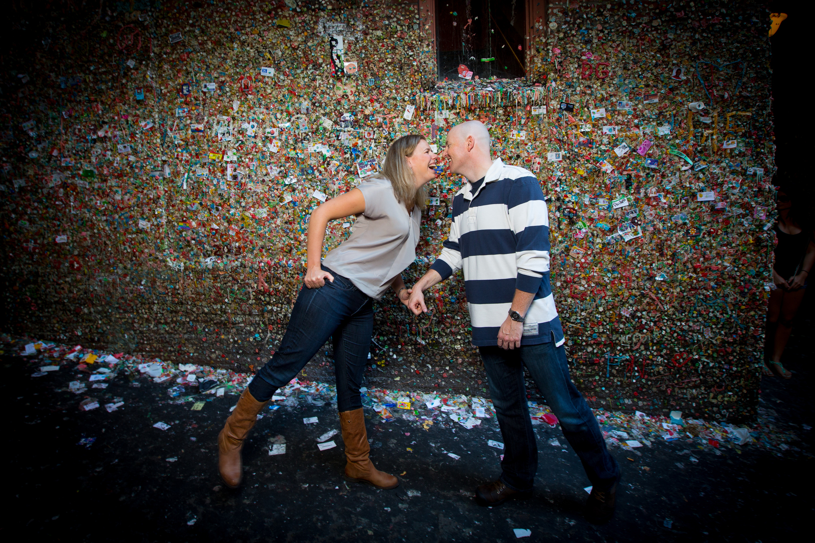 The Jennifer & Lincoln make a stop at the gum wall during their Seattle Pike Place Market engagement session. (Photography by Scott Eklund /Red Box Pictures)