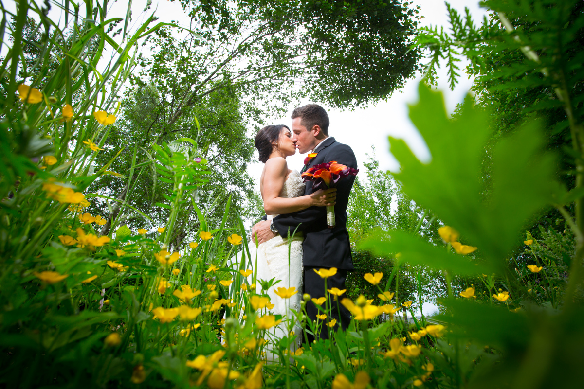 The bride and groom kiss following their Cedarbrook Lodge wedding in Seattle, Washington. (Wedding Photography by Scott Eklund - Red Box Pictures)