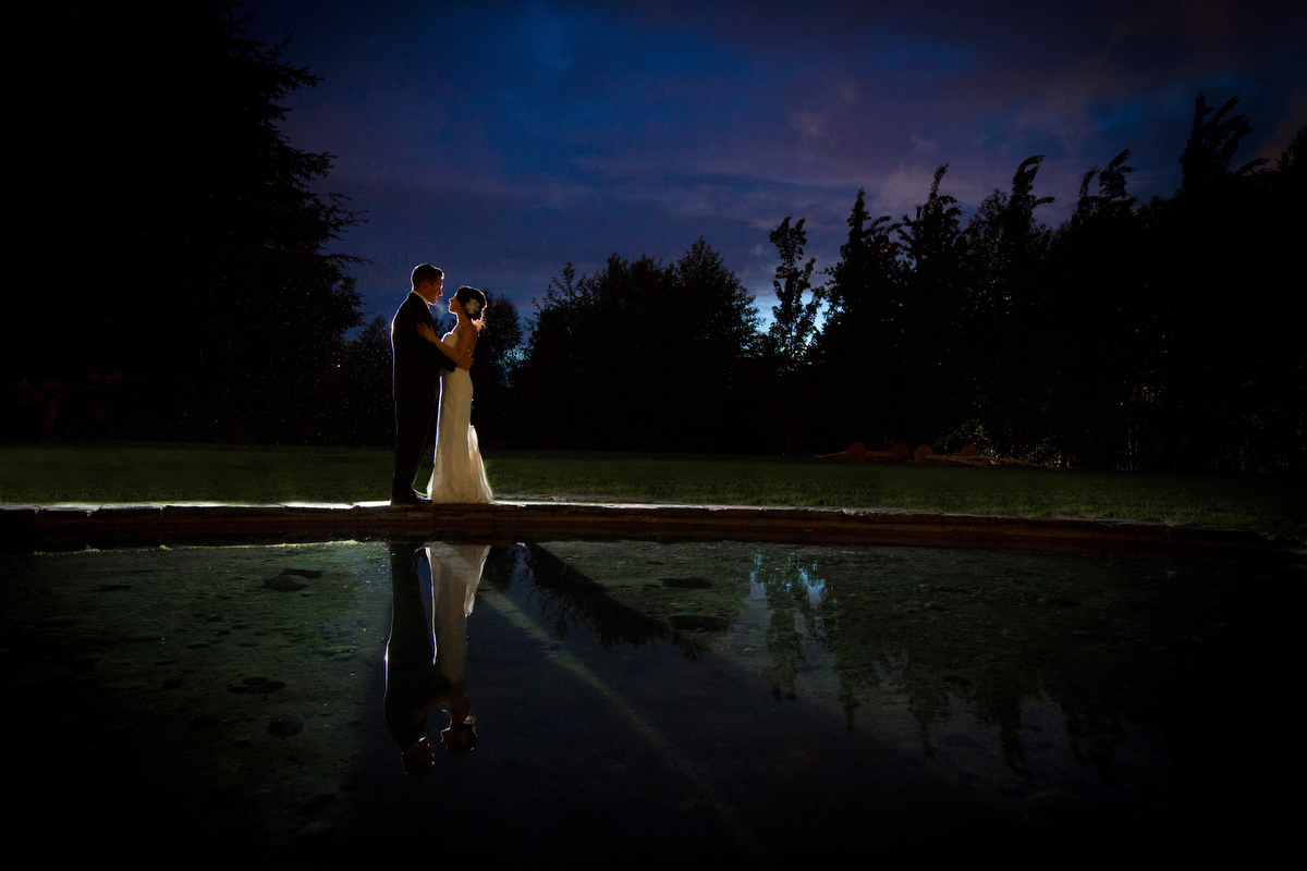 The bride and groom share a quiet moment at their Cedarbrook Lodge wedding in Seattle, Washington. (Wedding Photography by Scott Eklund - Red Box Pictures)