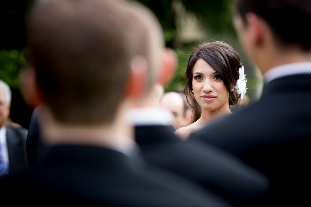 The bride looks at the groom during their wedding at Cedarbrook Lodge in Seattle, Washington. (Wedding Photography by Scott Eklund - Red Box Pictures)