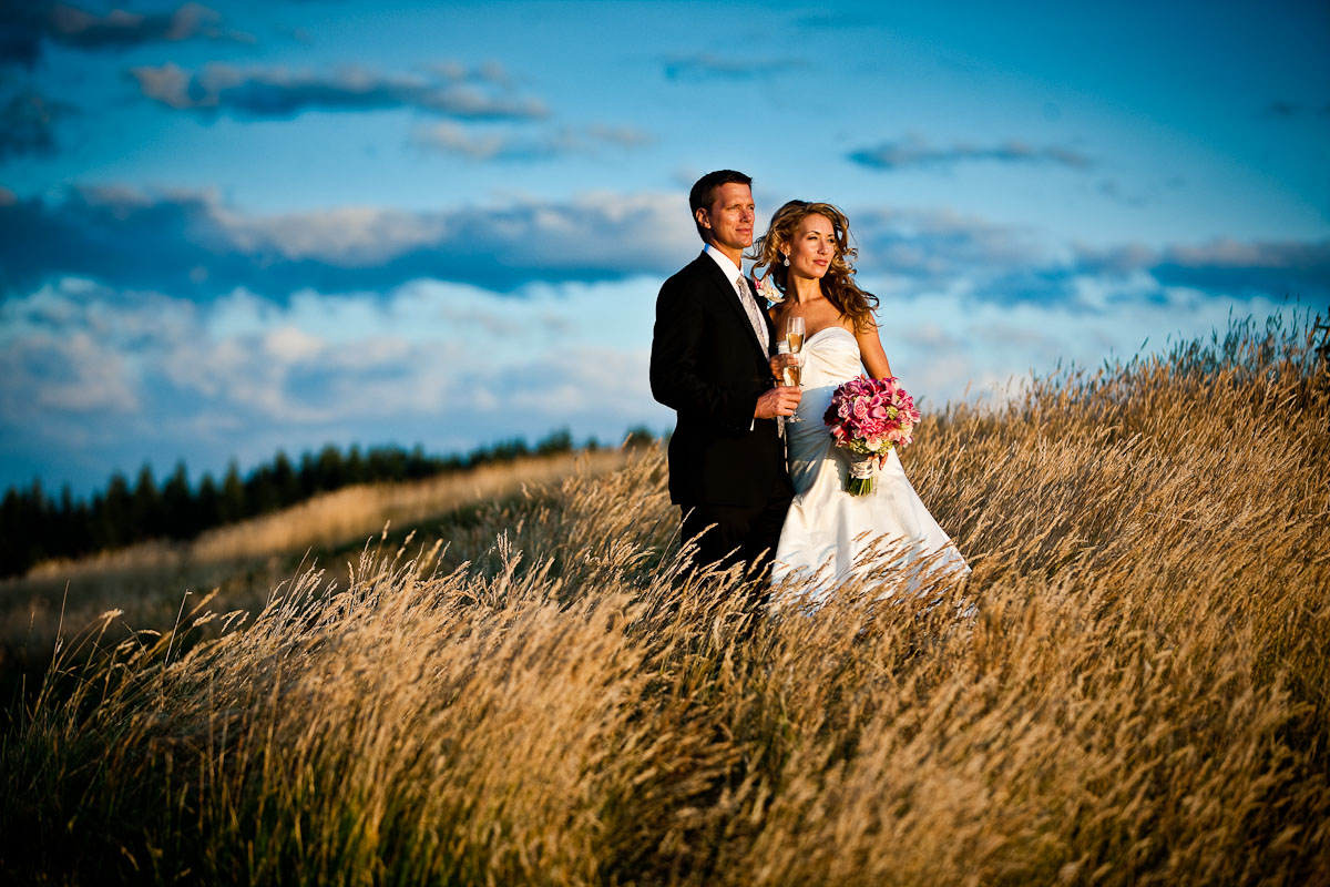 Pauline and Scott watch the sun set while standing in the tall grass at the Golf Club at Newcastle in Bellevue, WA. (Photo by Scott Eklund/Red Box Pictures)