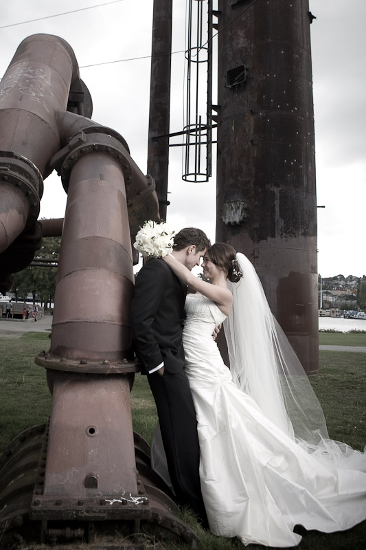 Silvia and Adrian embrace during a portrait among the exposed pipes at Gasworks Park in Seattle prior to their wedding. (Photo by Scott Eklund/Red Box Pictures)