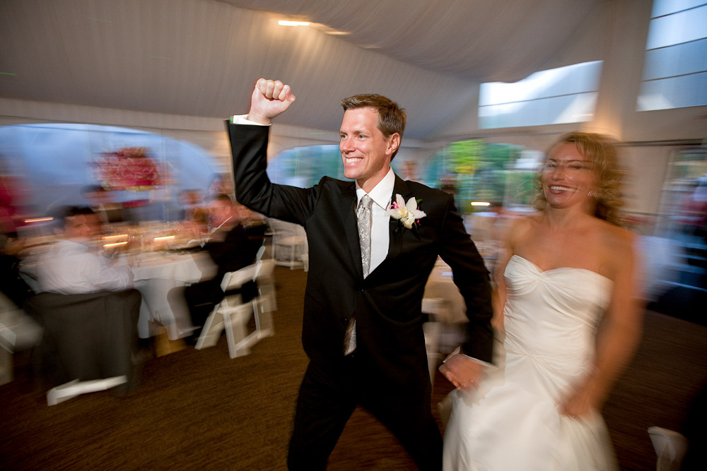 Scott pumps his fist as he and his bride Pauline are introduced at their reception at the Golf Club at Newcastle near Seattle. (Photography by Scott Eklund/Red Box Pictures)