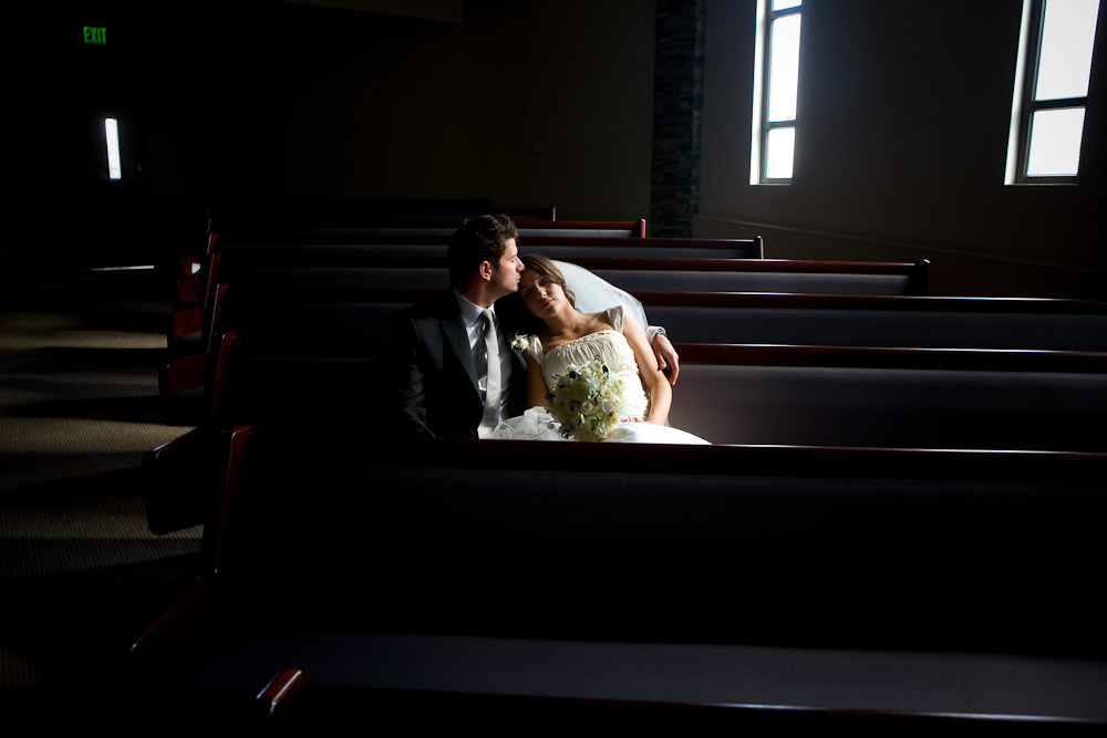 Silvia and Adrian share a quiet moment of solitude in the pews immediately following their wedding ceremony at First Romanian Pentecostal Church in Bothell, WA. (Photo by Scott Eklund/Red Box Pictures)