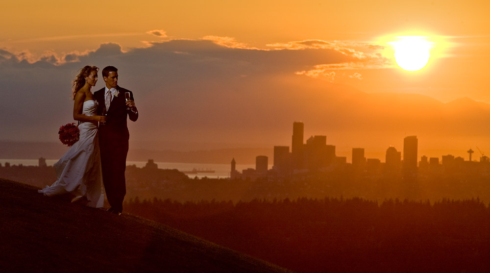 Pauline and Scott check out the view of the Seattle skyline at sunset from the Golf Club at Newcastle. (Photography by Scott Eklund/Red Box Pictures)