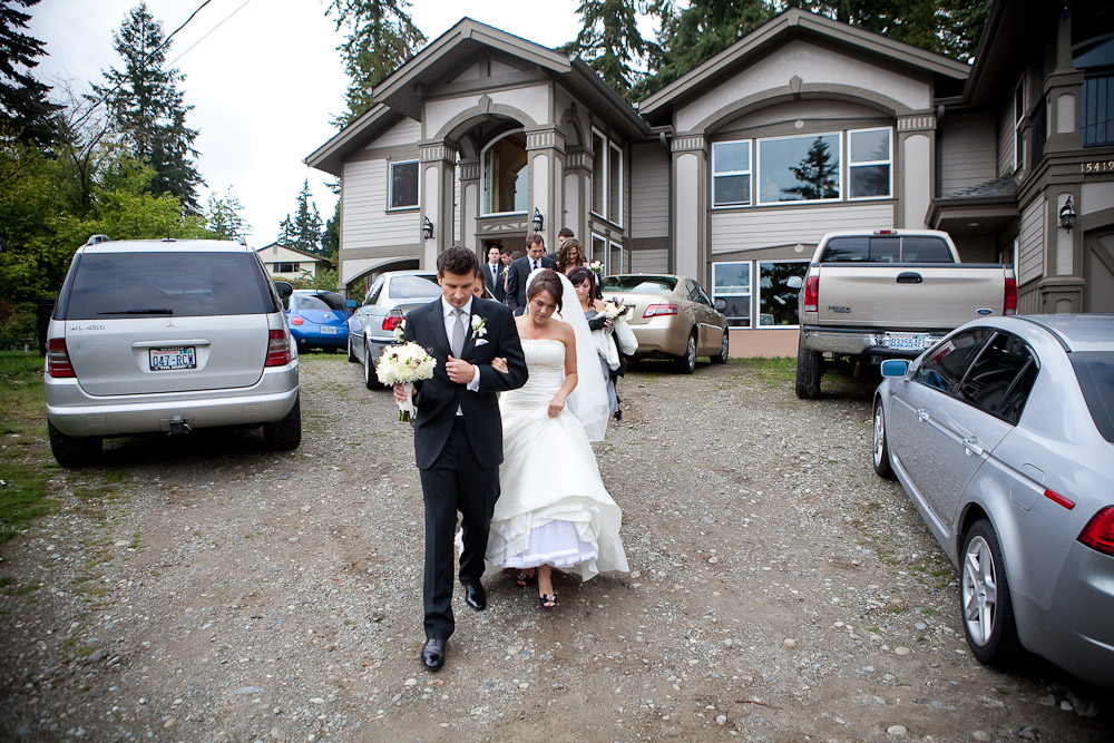 Adrian leads Silvia down a slope from her house to their waiting limousine in Bothell, WA. They were off to take pictures and go on to their wedding reception. (Photo by Andy Rogers/Red Box Pictures)