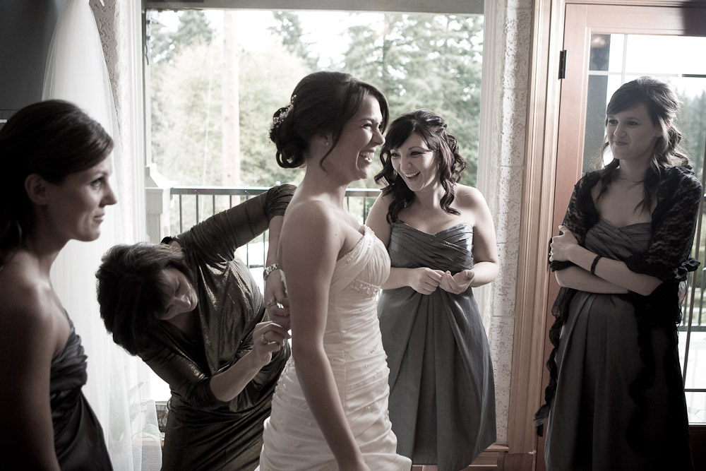 Silvia's brides maids zip up her wedding dress as she is heckled by Adrian's groomsmen at her home in Bothell, WA (Photo by Scott Eklund/Red Box Pictures)
