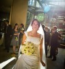 Silvia is bathed in sunlight as she arrives with her wedding party at the lobby of the Hyatt Regency for her wedding reception in Bellevue, WA. (Photo by Scott Eklund/Red Box Pictures)