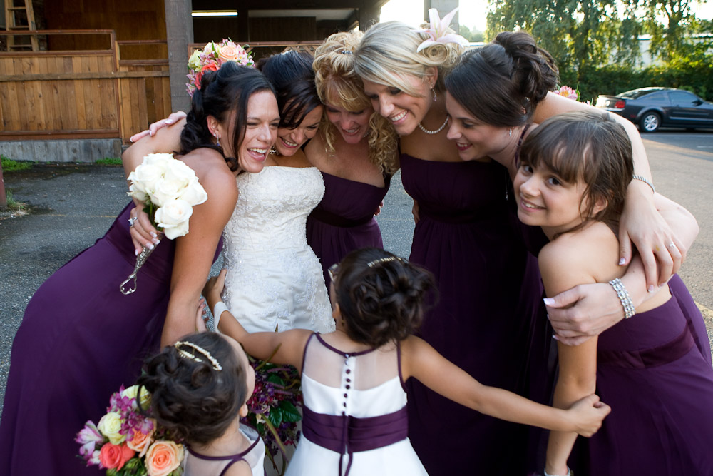 Michelle and her bridesmaids and flower girls have a group hug at The Attic in Sumner, WA.(Photography by Scott Eklund/Red Box Pictures)
