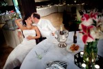 Michelle & Matt kiss during their reception at The Attic, in Sumner, WA. (Photography by Andy Rogers/Red Box Pictures)