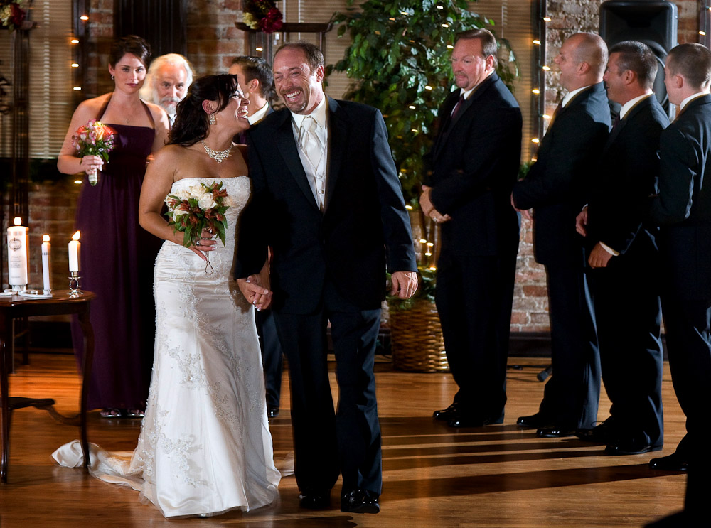 Michelle and  Matt were all smiles as they walk down the aisle as husband and wife after their wedding ceremony at The Attic in Sumner, WA. (Photo by Scott Eklund/Red Box Pictures)