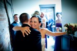 Michelle hugs a groomsman after her wedding at The Attic in Sumner, Wash.(Photography by Andy Rogers/Red Box Pictures)