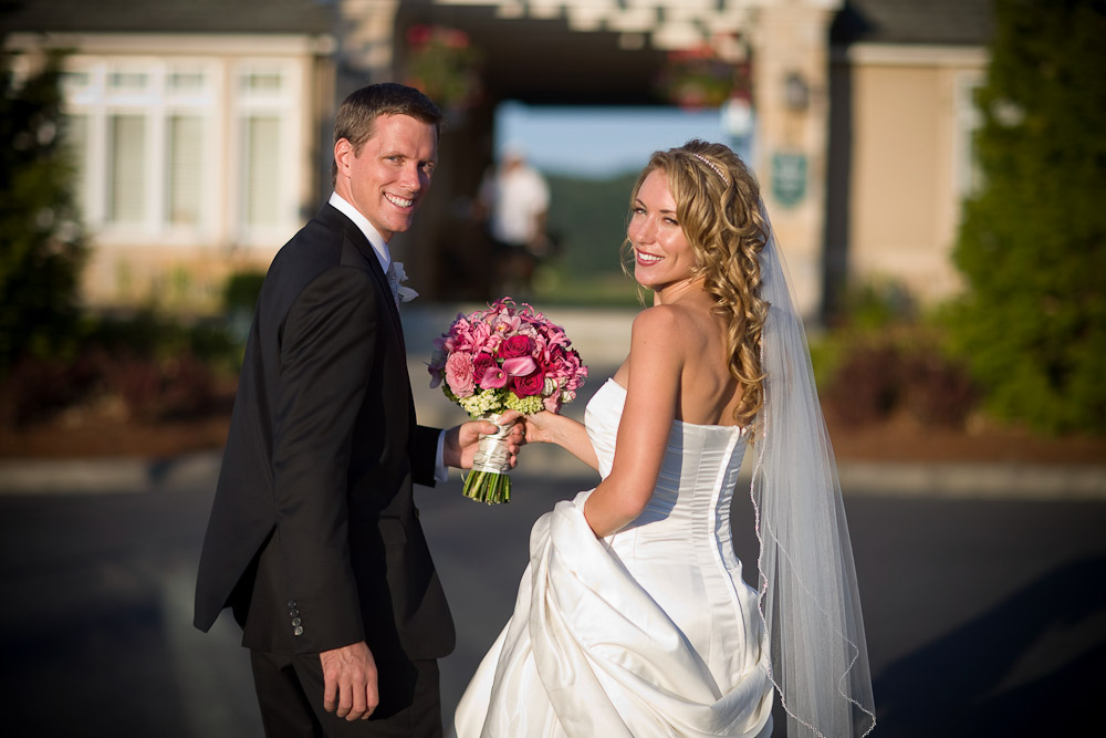 Scott and Pauline are all smiles after walking down the aisle at their wedding at the Golf Club at Newcastle near Seattle. (Wedding Photography by Scott Eklund/Red Box Pictures)