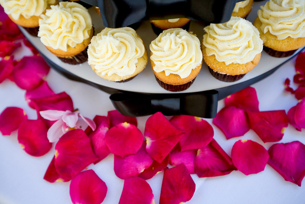 Cupcakes and rose petals at Scott and Pauline's reception at the Golf Club at Newcastle near Seattle. (Photography by Scott Eklund/Red Box Pictures)