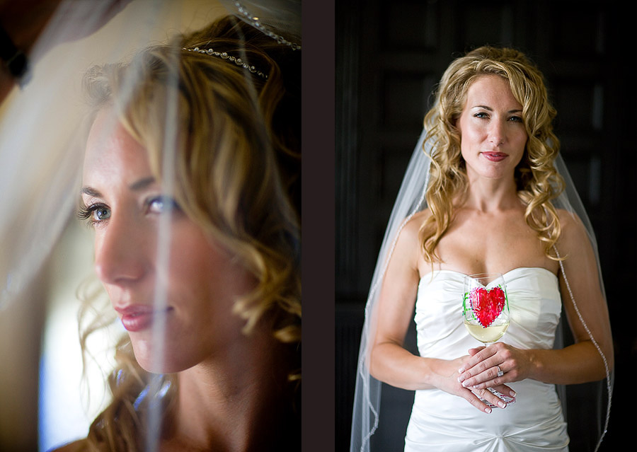 Pauline with her veil down and holding a glass of wine with a red heart on it, that she hand painted, just before the start of her wedding at the Golf Club at Newcastle. (Wedding Photography by Scott Eklund/Red Box Pictures)