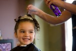 The flower girl gets her hair done before Matt & Michelle's wedding in Sumner, WA. (Photography by Scott Eklund/Red Box Pictures)