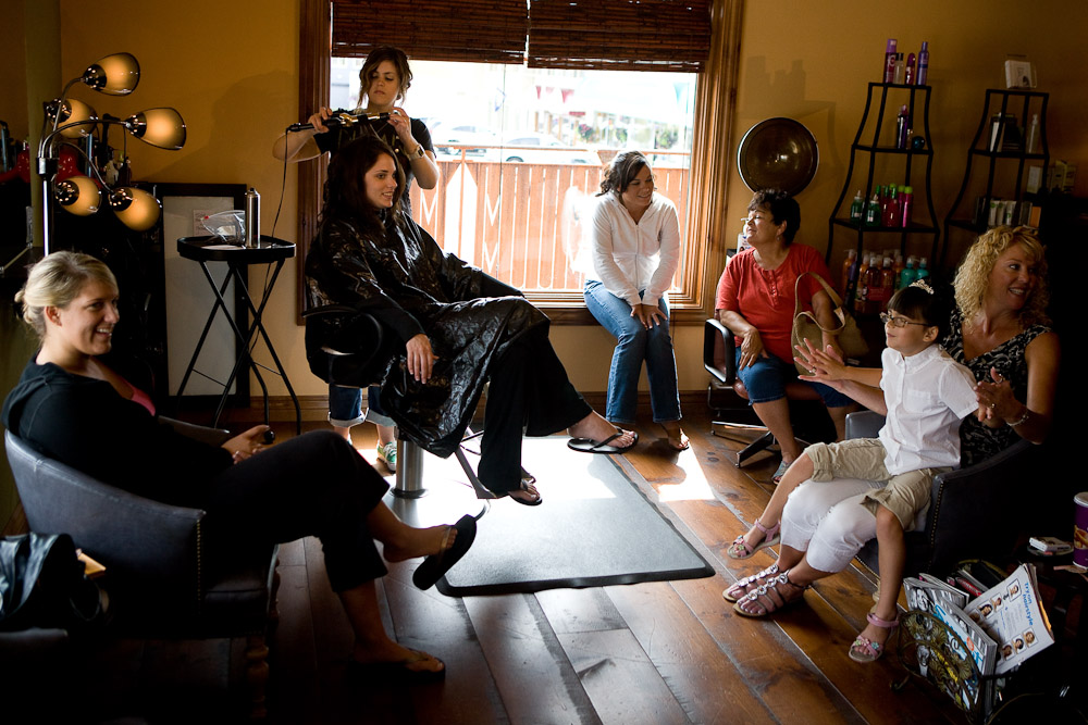 The bridal party gets their hair done at a salon before Matt & Michelle's wedding in Sumner, WA. (Photography by Scott Eklund/Red Box Pictures)
