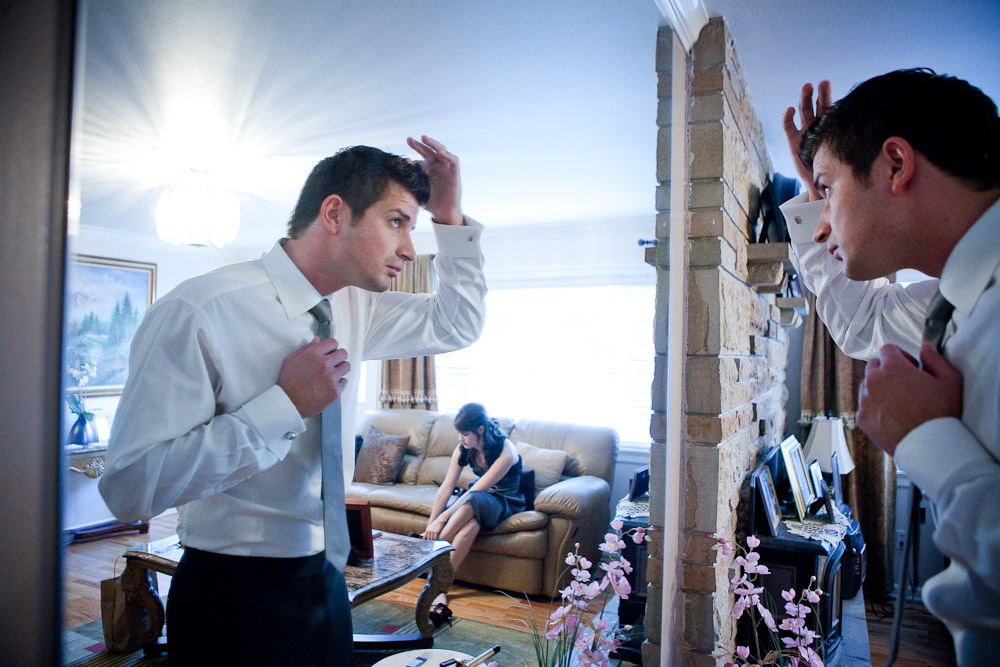 Adrian checks his hair in the mirror at his Bothell, WA home as he prepares himself for his wedding later in the day. (Photo by Andy Rogers/Red Box Pictures)