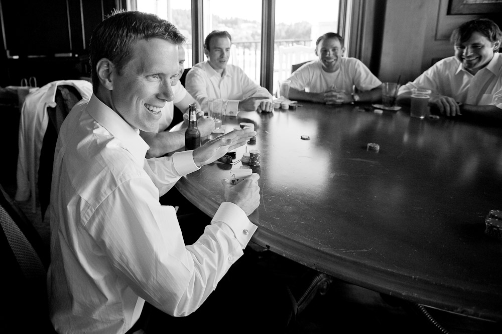 The groom Scott (left) plays poker with his groomsmen prior to his wedding at the Golf Club at Newcastle near Seattle. (Wedding Photography by Scott Eklund/Red Box Pictures)