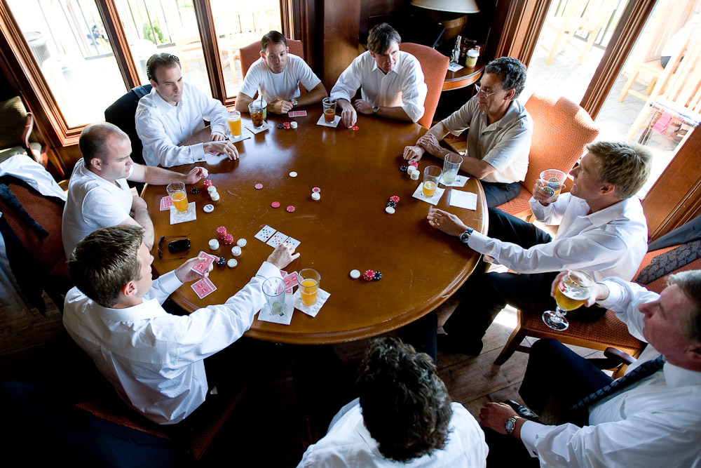 The groom Scott (lower left) plays poker with his groomsmen prior to the start of his wedding at the Golf Club at Newcastle near Seattle.(Wedding Photography by Scott Eklund/Red Box Pictures)