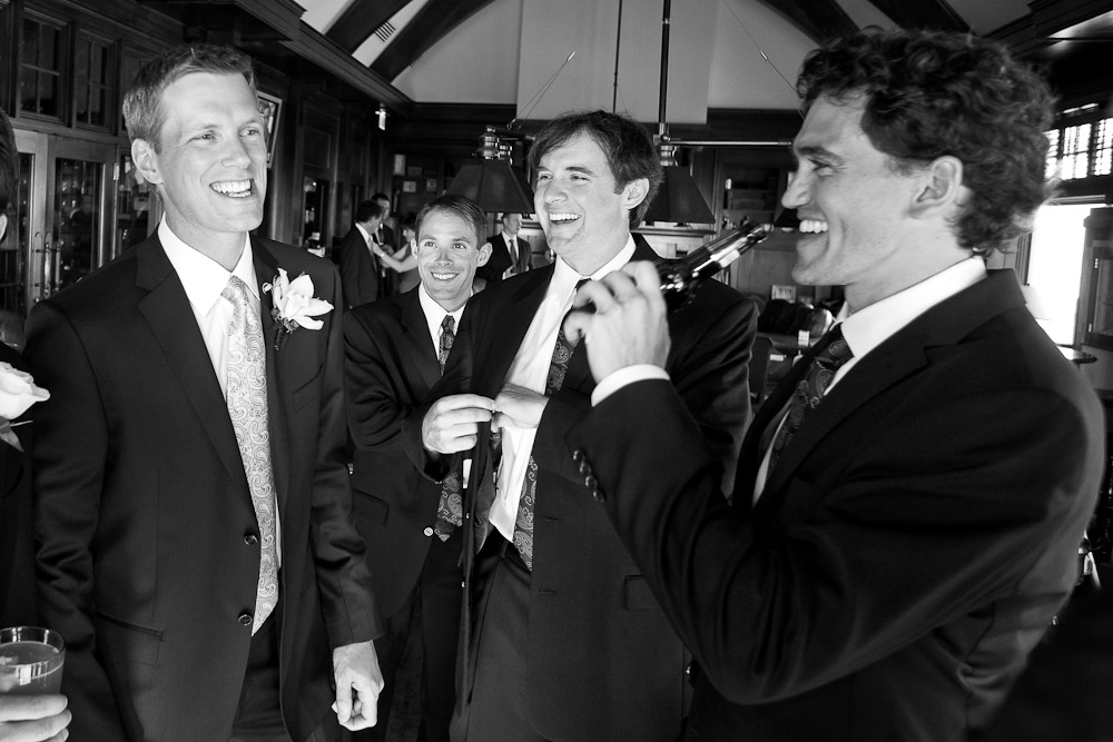 Scott (left) shares some beer and laughs with his groomsmen prior to the start of his wedding at the Golf Club at Newcastle near Seattle. (Wedding Photography by Scott Eklund/Red Box Pictures)