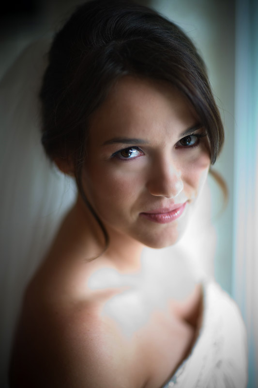 A right of portrait of Silvia wearing her wedding dress as she gets ready for her wedding at her Bothell home. (Photo by Scott Eklund/Red Box Pictures)