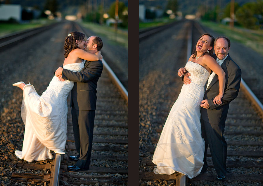 Matt & Michelle laugh as they walk along the railroad tracks in Sumner, Washington after their wedding at The Attic. (Photography by Scott Eklund/Red Box Pictures)