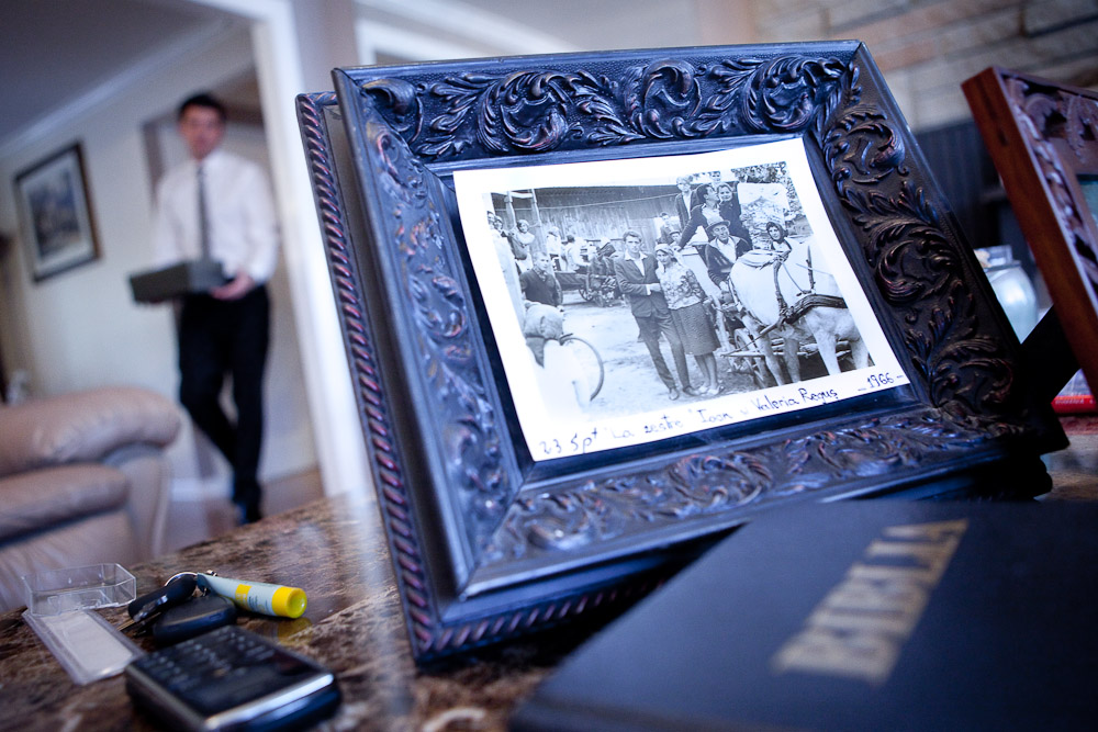 A bible and framed picture of Adrian's parents as a young couple in Romania lay on the table as he prepares for his wedding at his Bothell, WA home. (Photo by Andy Rogers/Red Box Pictures)