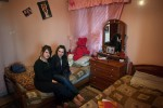 Sherien, 17, and her sister Nirseem, 16, in their bedroom just outside of Beddowi camp, Tripoli, Lebanon.